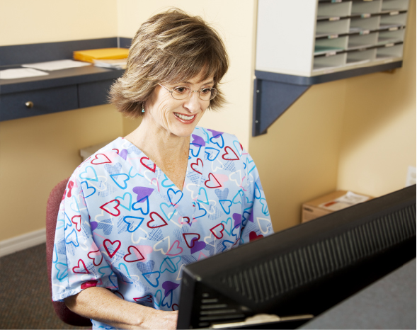 a receptionist in a hospital working on a computer