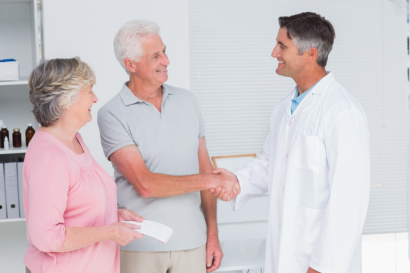 Doctor greets patient and caregiver to improve patient outcomes via caregiver engagement