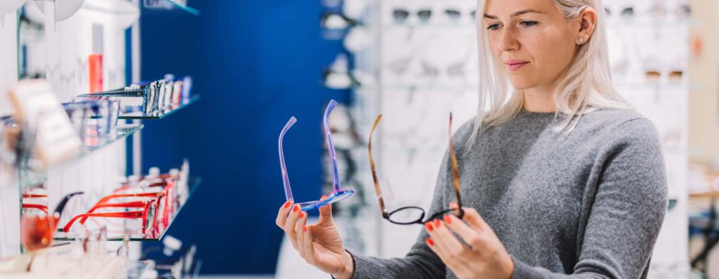 young woman looking at eye glass case