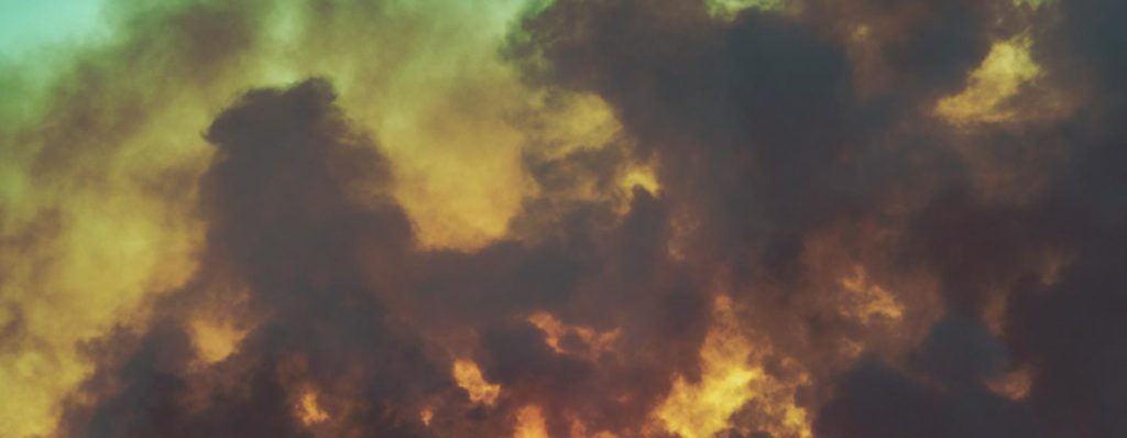 cloudy sky at dusk with smoke