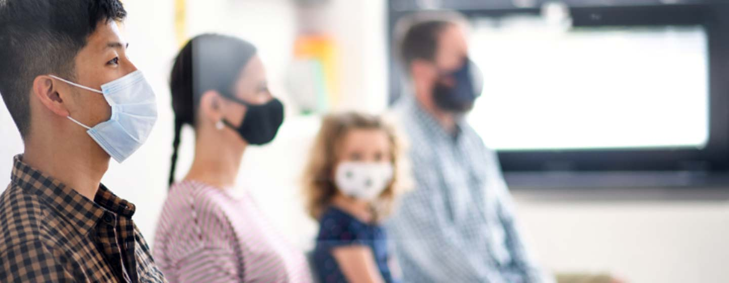 masked patients in waiting room