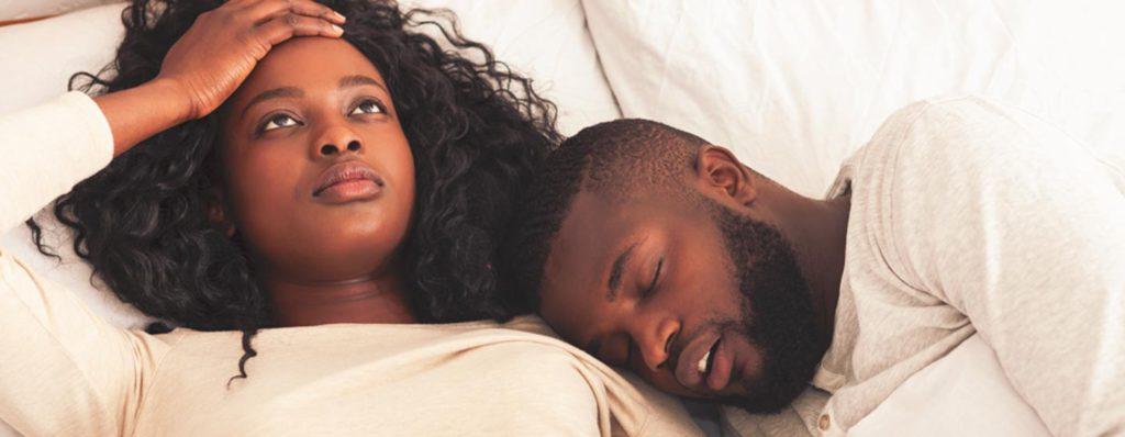 couple sleeping one snoring